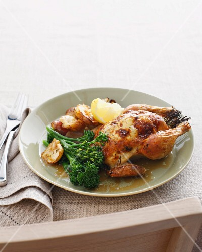 Roast spatchcock with broccolini and roast potatoes