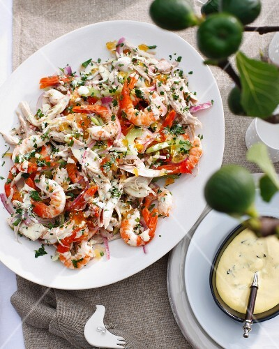 Plate of salad with turkey, prawns and celery