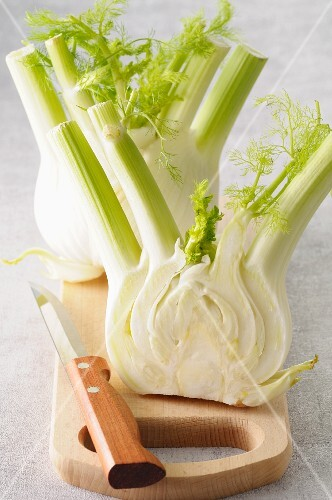 A bulb of fresh fennel on a chopping board