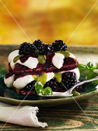 Blackberry tiramisu with cream and basil