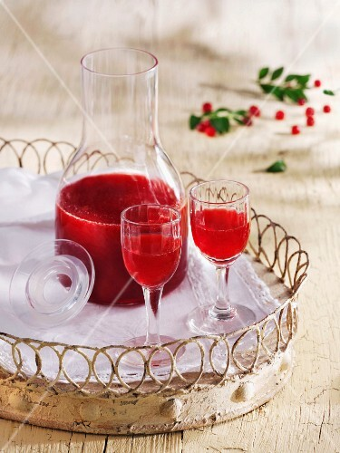 Home-made cranberry liqueur on a tray