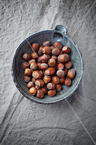 Lots of hazelnuts in a bowl