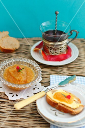 Pumpkin jam in a bowl and on a slice of bread and butter