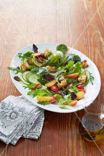A party salad with apple and croutons