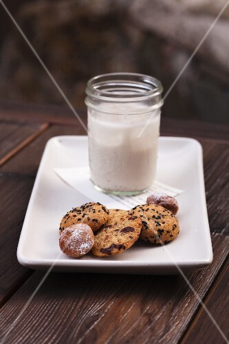 Assorted Cookies with a Glass of Almond Milk