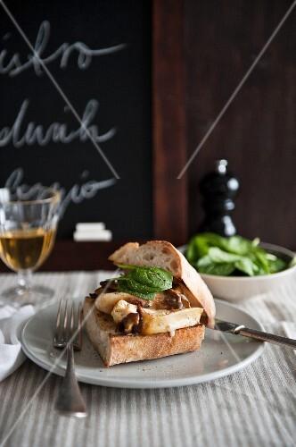 A mushroom and basil sandwich