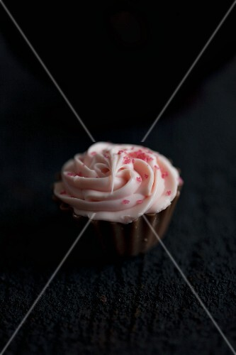 A chocolate filled with strawberry cream