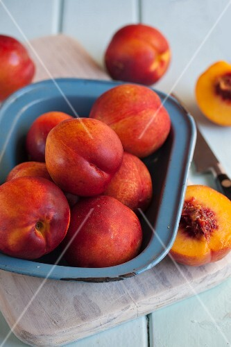 Several nectarines, whole and cut in half