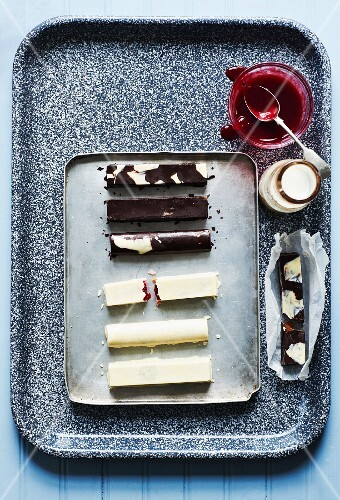 Home-made bars of chocolate filled with caramel and with jam