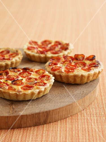 Tomato tartlets on a wooden board