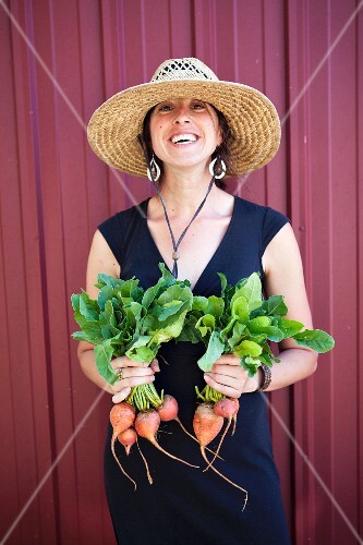 A Woman Holding Fresh Golden Beets
