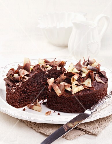 Chocolate cake with chocolate curls, cut in half