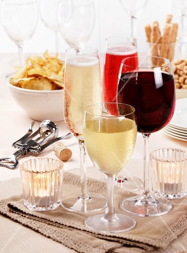 Assorted glasses of wine and sparkling wine, with party snacks