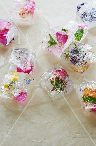 Ice cubes containing a variety of edible flowers