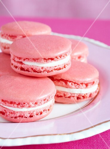 Pink macaroons on a plate (close-up)