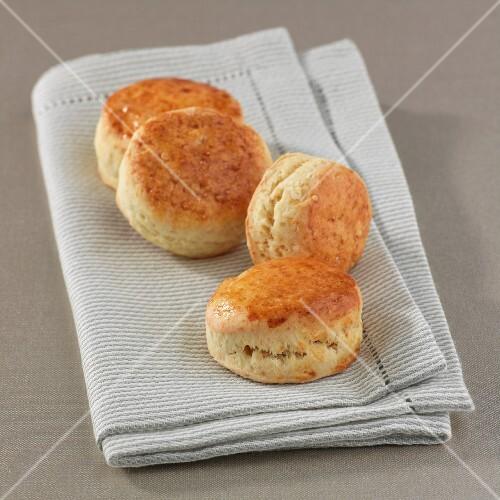 Four scones on a tea towel