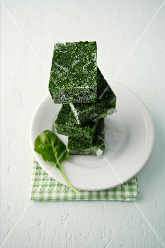 Frozen cubes of spinach, stacked
