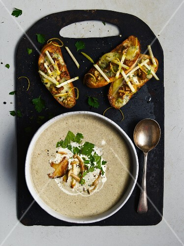 Mushroom soup and crostini topped with mushrooms