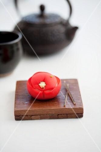 Wagashi camellia (tsubaki) with a teapot (Japan)