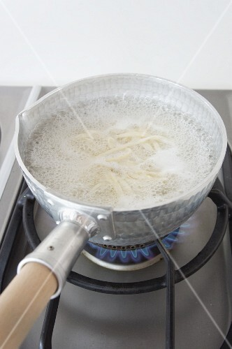 Soba noodles in boiling water (Japan)