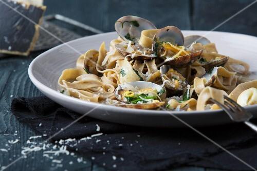 Tagliatelle with venus clams, herbs and lemon zest