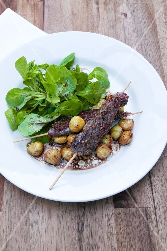 Venison skewers with watercress salad and chestnuts