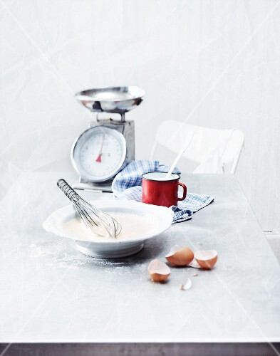 Ingredients for Pfeffernüsse (spiced soft gingerbread from Germany) with kitchen scales and a whisk