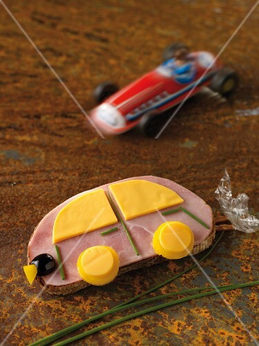 A ham car with cheese and chives