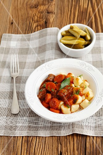Beef stew with potato gnocchi and pickled gherkins