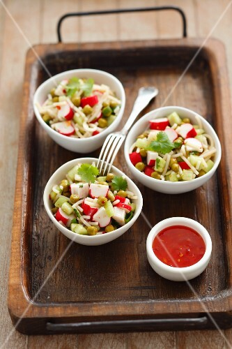 Noodle salad with surimi, cucumber, peas, coriander and chilli sauce (Asia)