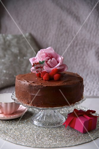 Chocolate cake decorated with raspberries and roses for Valentine's Day