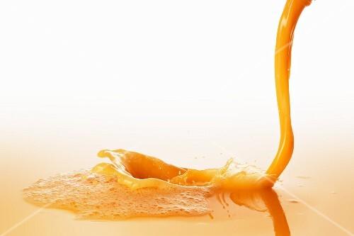 Orange juice with a stream of juice