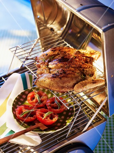 Chicken and tomatoes on the grill