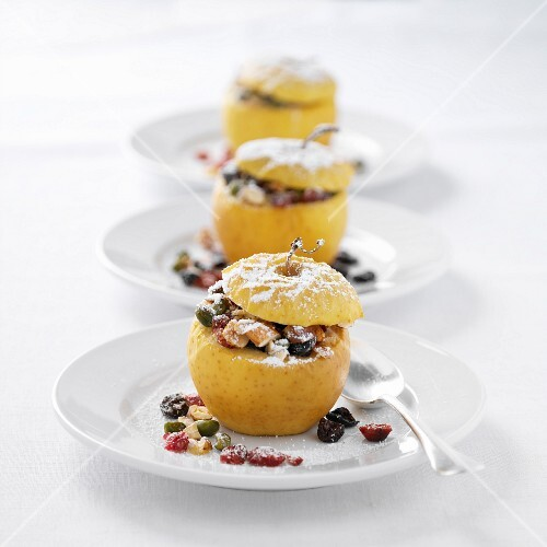 Baked apples with dried fruit and icing sugar