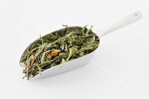 Dried dandelion leaves on a scoop