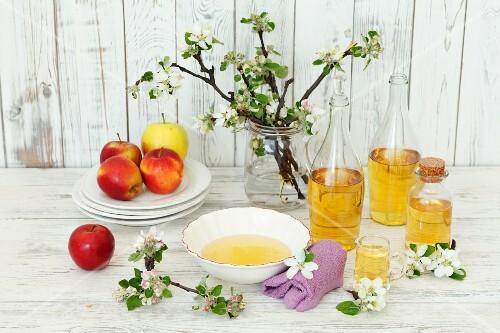 Cider vinegar, fresh apples and apple blossom