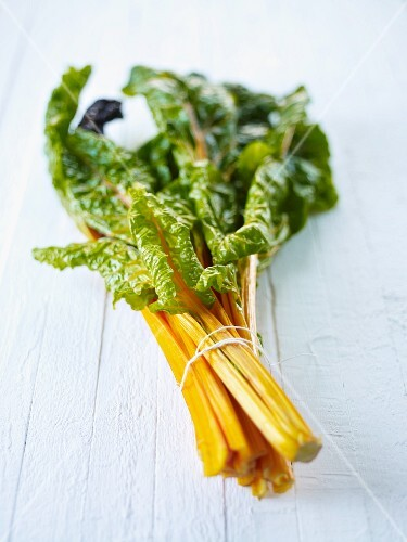 Stalks of yellow chard, tied in a bunch