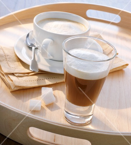 Wiener Melange (coffee with frothy milk, Austria) and a macchiato