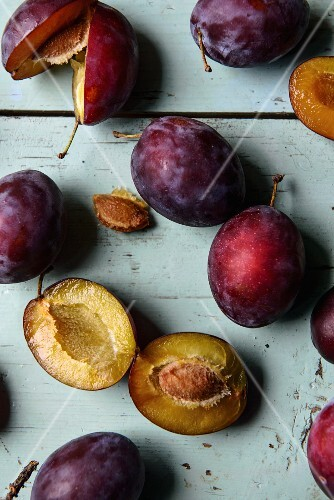 Plums, whole and halved