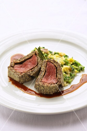 Venison in a poppy seed crust with savoy cabbage ragout