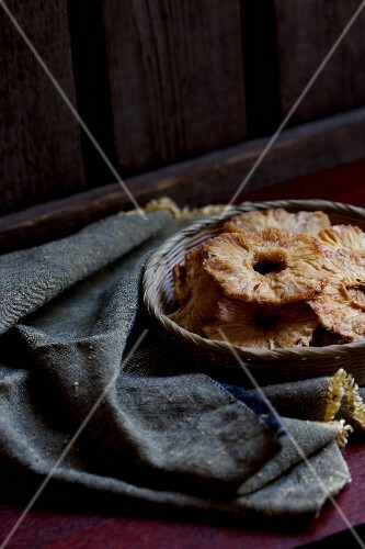Dried pineapple rings in a basket