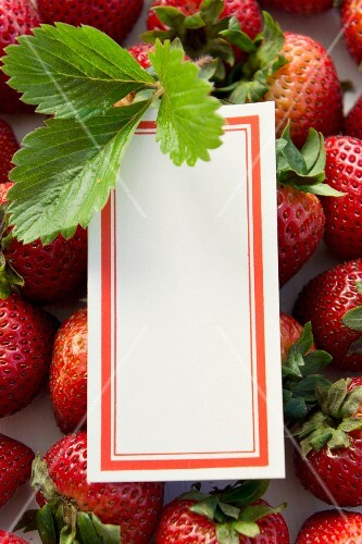 Strawberries, strawberry leaves and a blank label