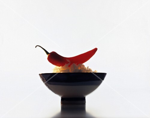 Asian eating bowl with rice and a chilli