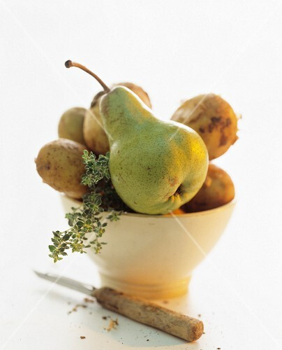 Potatoes, pears and thyme in a bowl