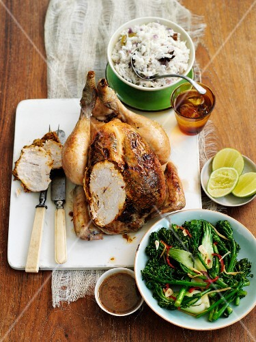 Roast chicken, partly sliced, with rice and vegetables (Thailand)