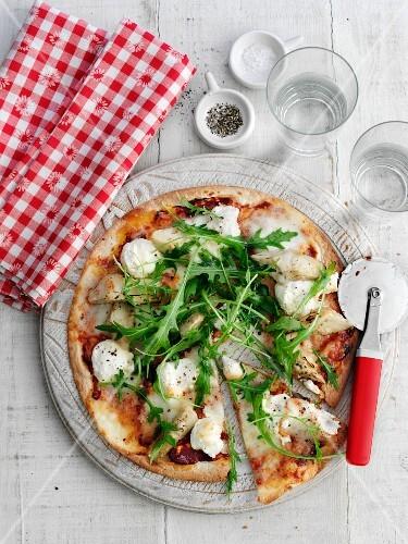 Tortilla pizza with mozzarella and rocket