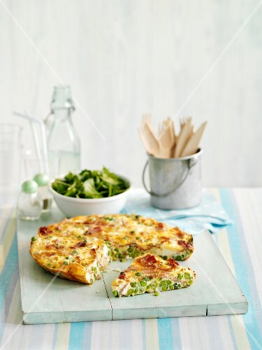 Frittata with peas, partly sliced