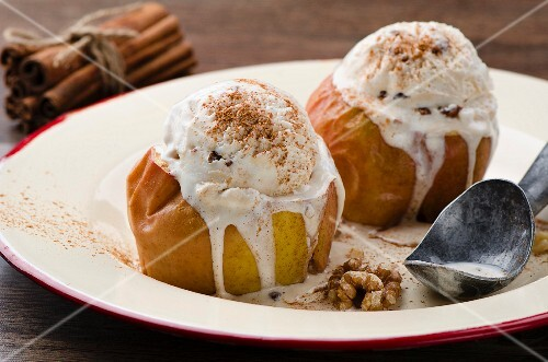 Baked apples with walnut ice cream and cinnamon