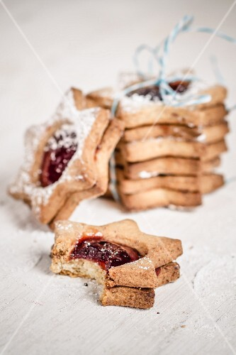 Cookie tower with ribbon and jelly filled cookie with a bite taken out of it