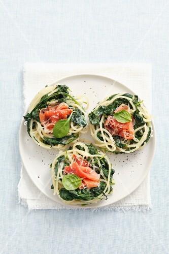 Spaghetti nests with spinach and prosciutto
